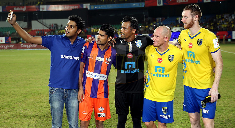 Samsung fan to take samsung galaxy grand prime grouipe during the presentation of the match 54 of the Hero Indian Super League between Kerala Blasters FC and FC Pune City held at the Jawaharlal Nehru Stadium, Kochi, India on the 9th December 2014.<br /> <br /> Photo by:  Sandeep Shetty/ ISL/ SPORTZPICS