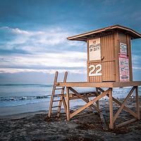 Photo of Newport Beach CA lifeguard tower 22 at sunrise along the Pacific Ocean. Balboa Peninsula is a popular area of Newport Beach in Orange County Southern California USA. Copyright ⓒ Paul Velgos with All Rights Reserved.
