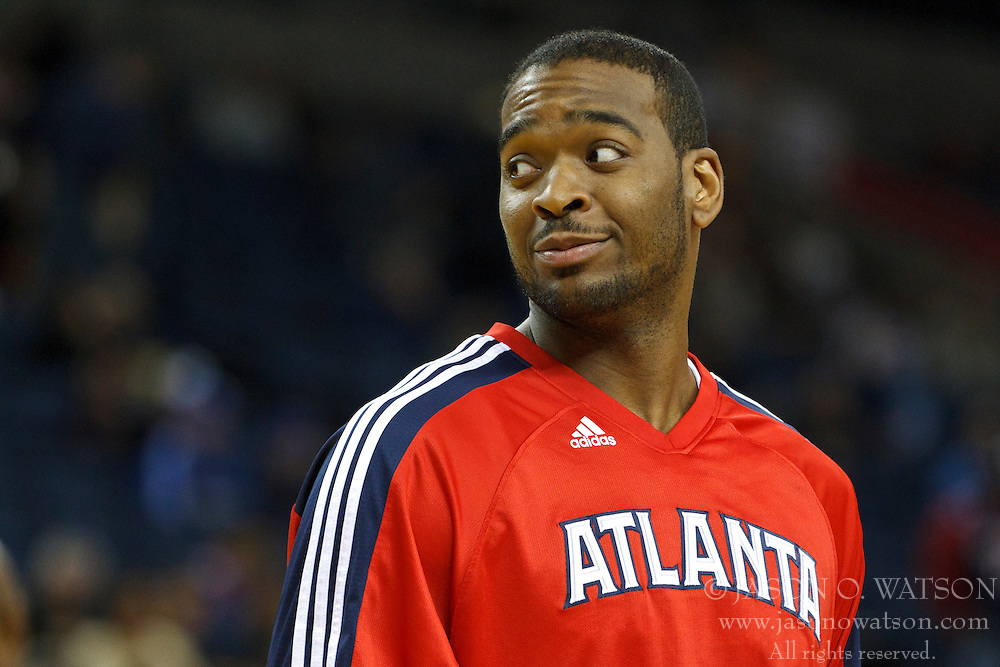 February 25, 2011; Oakland, CA, USA;  Atlanta Hawks center Josh Powell (12) warms up before the game against the Golden State Warriors at Oracle Arena. Atlanta defeated Golden State 95-79.