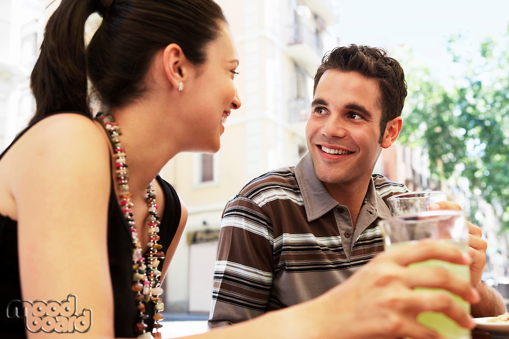 Young couple with drinks portrait