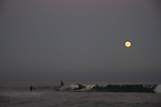 Surfing under a full moon, Malibu.