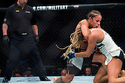Liz Carmouche scores a takedown against Katlyn Chookagian during UFC 205 at Madison Square Garden in New York, New York on November 12, 2016.  (Cooper Neill for The Players Tribune)