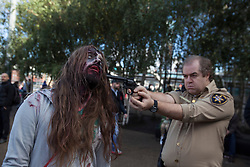 © licensed to London News Pictures. London, UK 13/10/2012. People posing with costumes in Southbank, London as more than 2,000 'zombies' celebrating World Zombie Day on 13/10/12 in London. Photo credit: Tolga Akmen/LNP