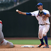 Ruben Tejada, New York Mets, turns a double play as Todd Frazier, Cincinnati Reds, slides into second base during the New York Mets V Cincinnati Reds Baseball game at Citi Field, Queens, New York. 22nd May 2012. Photo Tim Clayton