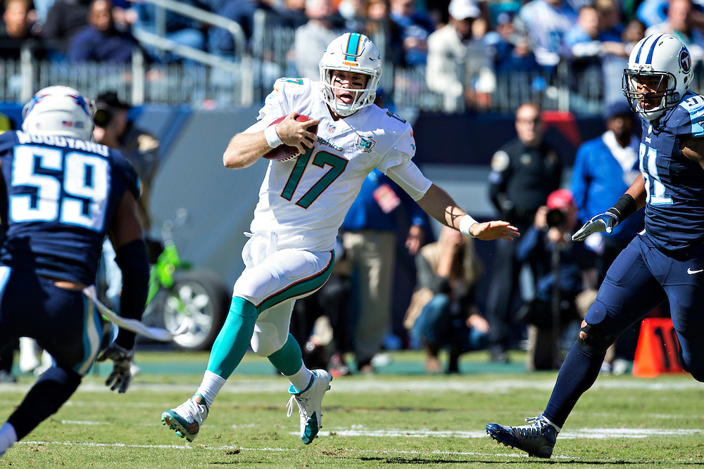 NASHVILLE, TN - OCTOBER 18:  Ryan Tannehill #17 of the Miami Dolphin runs the ball in the first half during a game against the Tennessee Titans at LP Field on October 18, 2015 in Nashville, Tennessee.  (Photo by Wesley Hitt/Getty Images) *** Local Caption *** Ryan Tannehill