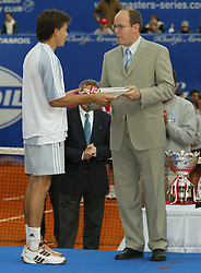 MONTE-CARLO, MONACO - Sunday, April 20, 2003: Guillermo Coria (Argentina) is presented with his runners-up sheild by Prince Albert of Monaco after his 6-2, 6-2 defeat in the final of the Tennis Masters Monte-Carlo. (Pic by David Rawcliffe/Propaganda)