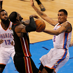 Jun 14, 2012; Oklahoma City, OK, USA; Miami Heat small forward LeBron James (6) and Oklahoma City Thunder shooting guard Thabo Sefolosha (2) go after a loose ball during the first quarter of game two in the 2012 NBA Finals at Chesapeake Energy Arena. Mandatory Credit: Derick E. Hingle-US PRESSWIRE