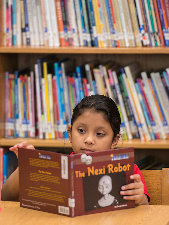 Brian Ching reads to students at the Rusk School, September 25, 2014.