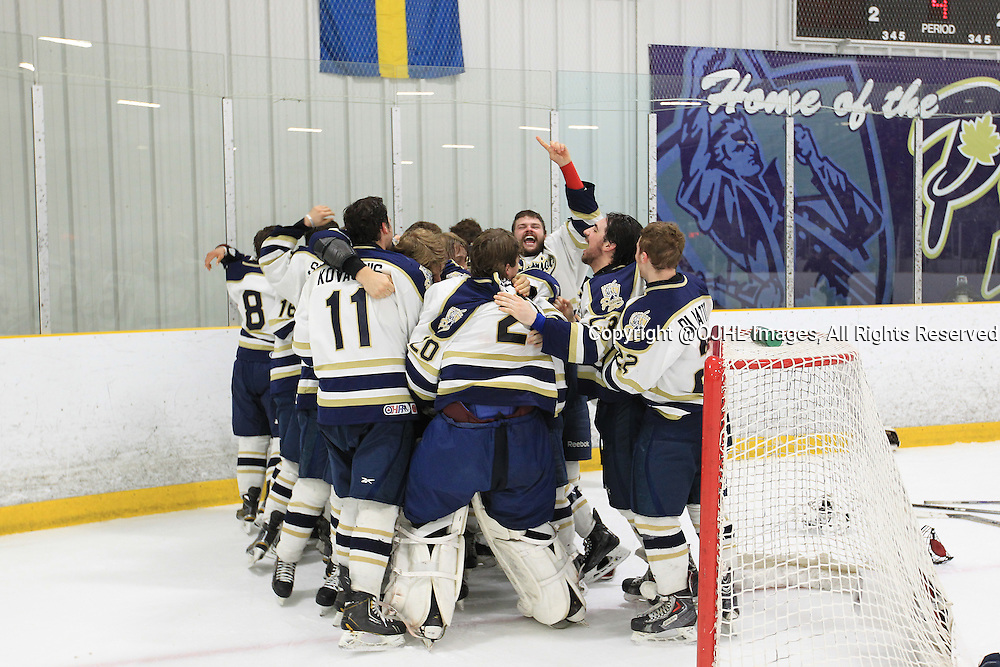 TORONTO, ON - Apr 22, 2015 : Ontario Junior Hockey League game action between the Toronto Patriots and the Kingston Voyageurs. Game seven of the Buckland Cup Championship Series. The Toronto Patriots celebrate the Buckland Cup Championship.<br /> (Photo by Tim Bates / OJHL Images)