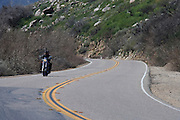 A motorcyclist navigtates an S-curve in Anza-Borrego Desert State Park, California