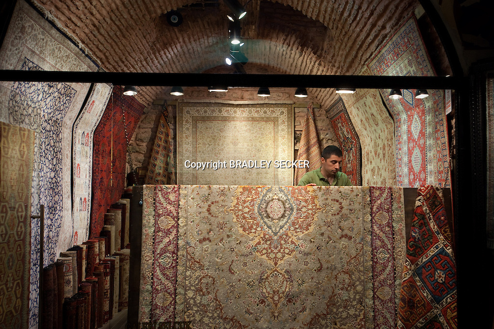 ISTANBUL, TURKEY, JUNE 2012: As the Grand Bazaar opens for another day of trading, a stall holder prepares the lighting on his carpet display om his shop for the days trade. (Photo by Bradley Secker for the Washington Post)