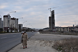 March 28, 2019 - Ankara, Turkey - A woman walks next to a road as modern skyscrapers under construction rise in a district some 20 kilometers outside the city center. (Credit Image: © Altan Gocher/ZUMA Wire)