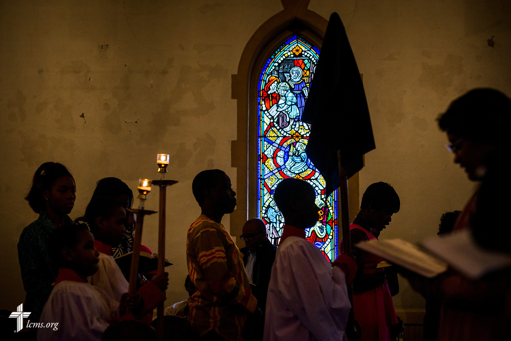 Parishioners turn toward the crucifix following the benediction at the Lutheran Church of the Redeemer, Baltimore, on Palm Sunday, March 25, 2018. LCMS Communications/Erik M. Lunsford