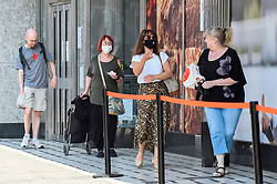 © Licensed to London News Pictures. 11/04/2020. WATFORD, UK. Customers wearing facemasks maintain their social distancing in a queue outside an M&S Foodhall in Watford shopping centre on Easter Saturday during lockdown as the coronavirus (COVID19) pandemic continues.  Photo credit: Stephen Chung/LNP