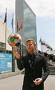 A.C. Milan's Keisuke Honda takes the global goals for a spin after touring the United Nations in New York, Tuesday, June 21, 2016. Honda was named United Nations Foundation Global Advocate for Youth. (Photo/Stuart Ramson for United Nations Foundation)
