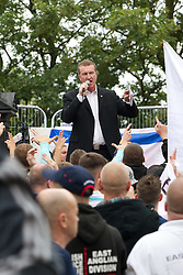 © Licensed to London News Pictures. 13/08/2011. Telford, UK. EDL leader, Kevin Carroll, addresses the crowd at an EDL demonstration in the small Telford town of Wellington. The group were going to march, however the Home Secretary imposed a ban on all marches in the area. About 300 EDL supporters attended. The EDL demonstration was counter-protested by about 300 people. Photo credit : Joel Goodman/LNP