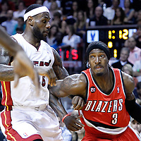 08 March 2011: Portland Trail Blazers small forward Gerald Wallace (3) drives past Miami Heat small forward LeBron James (6) during the Portland Trail Blazers 105-96 victory over the Miami Heat at the AmericanAirlines Arena, Miami, Florida, USA.