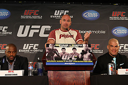 August 4, 2011; Philadelphia, PA; USA; UFC President Dana White is flanked by Rashad Evans and Vitor Belfort at the final press conference for UFC 133 at the Independence Visitors Center.