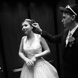 "Newlyweds Casey Dalton (right, age 17) fixes the hair of his wife, Jessica Dalton (left, age 17), in an elevator on their way to their senior prom. Jessica, who is a senior at William Fleming, and Casey, who recently received his GED, have been dating since August, and currently live together at Casey's parents house. Jessica and Casey attended William Fleming's ""A Night in Paris"" prom hours after getting married. Monday, Jessica will be back at William Fleming to finish here senior year, while Casey will go back to his job as a diesel mechanic."