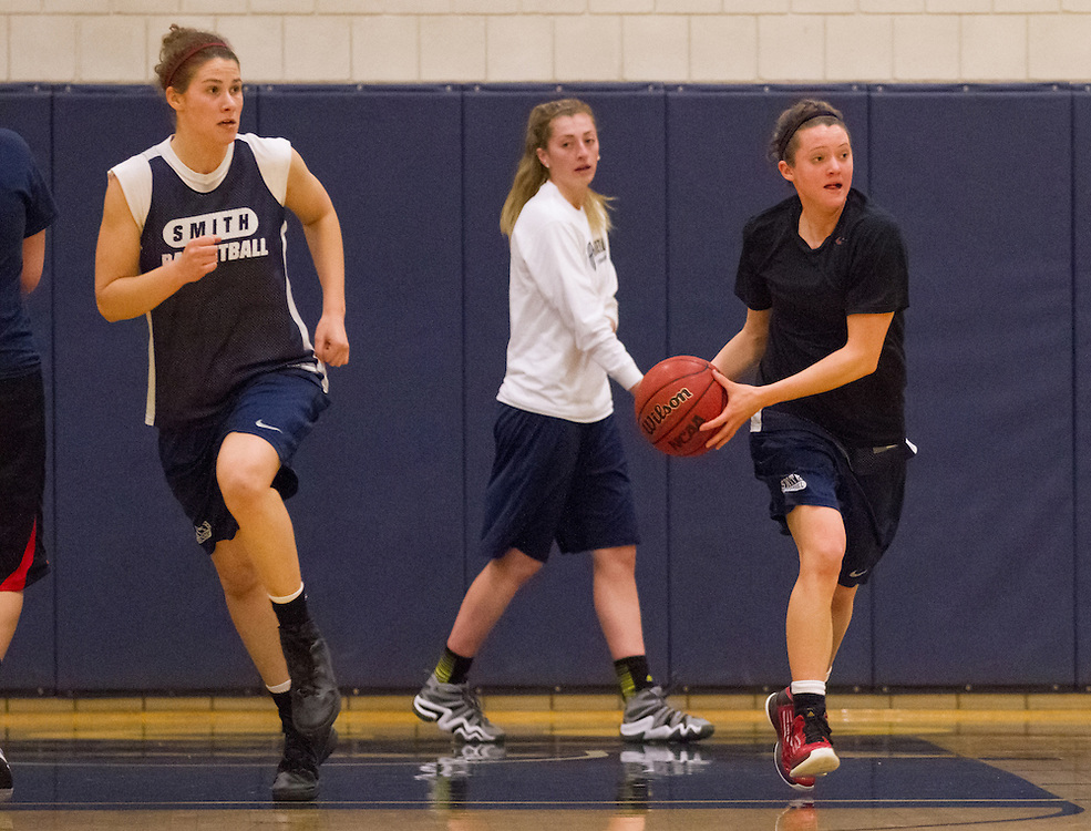(L to R) Smith College Pioneers' Rosa Drummond, Assistant Coach Michelle Lafond (in background), are Devon Quattrocchi are pictured during team practice on Wednesday, February 27, 2013. The Pioneers are in the NCAA tournament for the first time and will play Southern Maine Huskies on Friday.  (Matthew Cavanaugh for The Boston Globe)The Smith College women's basketball team practices on the Senda Berenson Court at Smith College on Wednesday, February 27, 2013.  (Photo by Matthew Cavanaugh)