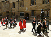 © Licensed to London News Pictures. 20/06/2012. Oxford, UK Aung San Suu Kyi (centre Left) arrives at Oxford University today 20 June 2012 ahead of receiving an Honary Degree at the Encaenia Ceremony.  The Burmese democracy leader is to receive an honorary doctorate in civil law at annual ceremony honouring the brightest and best. Other honorees include: former MI5 Director General Baroness Manningham-Buller; author David John Moore Cornwell (aka John le Carre); Harvard University president Professor Drew Gilpin Faust; and Sony chief executive Sir Howard Stringer. Photo credit : Stephen Simpson/LNP
