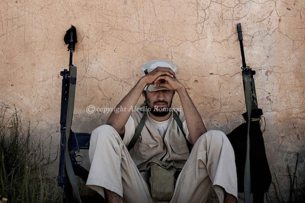 LIBYAN ARAB JAMAHIRIYA, Gualish : Libyan rebels man near the flashpoint hilltop town of Gualish on July 14, 2011 where intense clashes with forces loyal to Moamer Kadhafi have left scores of casualties. ALESSIO ROMENZI