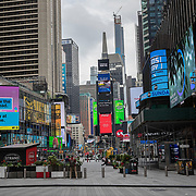 Times Square remains virtually empty with closed businesses and limited traffic due to the Coronavirus (Covid-19) outbreak in New York City on Monday, May 11, 2020.  Nonessential businesses have been closed and large gatherings have been banned across the state since March 22 under an emergency order issued by Governor Cuomo that is set to expire on Friday. (Alex Menendez via AP)