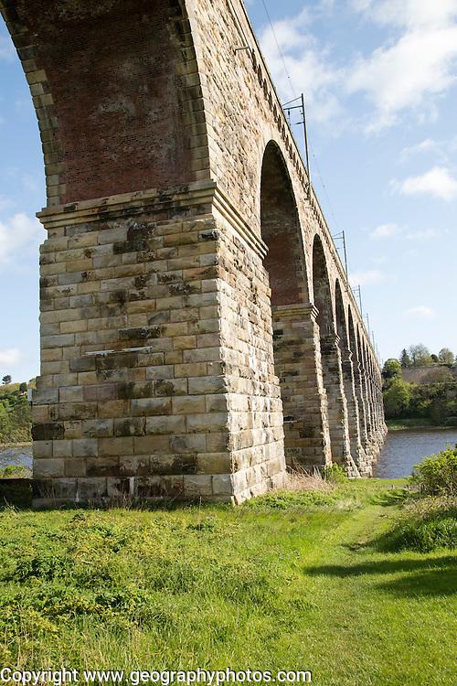 Stone arches of railway viaduct crossing River Tweed, Berwick-upon-Tweed, Northumberland, England, UK