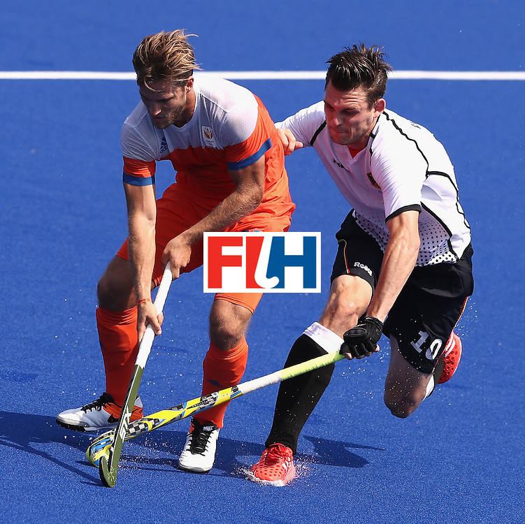 RIO DE JANEIRO, BRAZIL - AUGUST 18:  Jeroen Hertzberger (L) of the Netherlands is tackled by Christopher Wesley during the Men's Bronze Medal match between the Netherlands and Germany on Day 13 of the Rio 2016 Olympic Games held at the Olympic Hockey Centre on August 18, 2016 in Rio de Janeiro, Brazil.  (Photo by David Rogers/Getty Images)