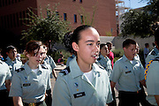 Participantsin a high school ROTC program march in the Veterans Day Parade, which honors American military veterans, in Tucson, Arizona, USA.