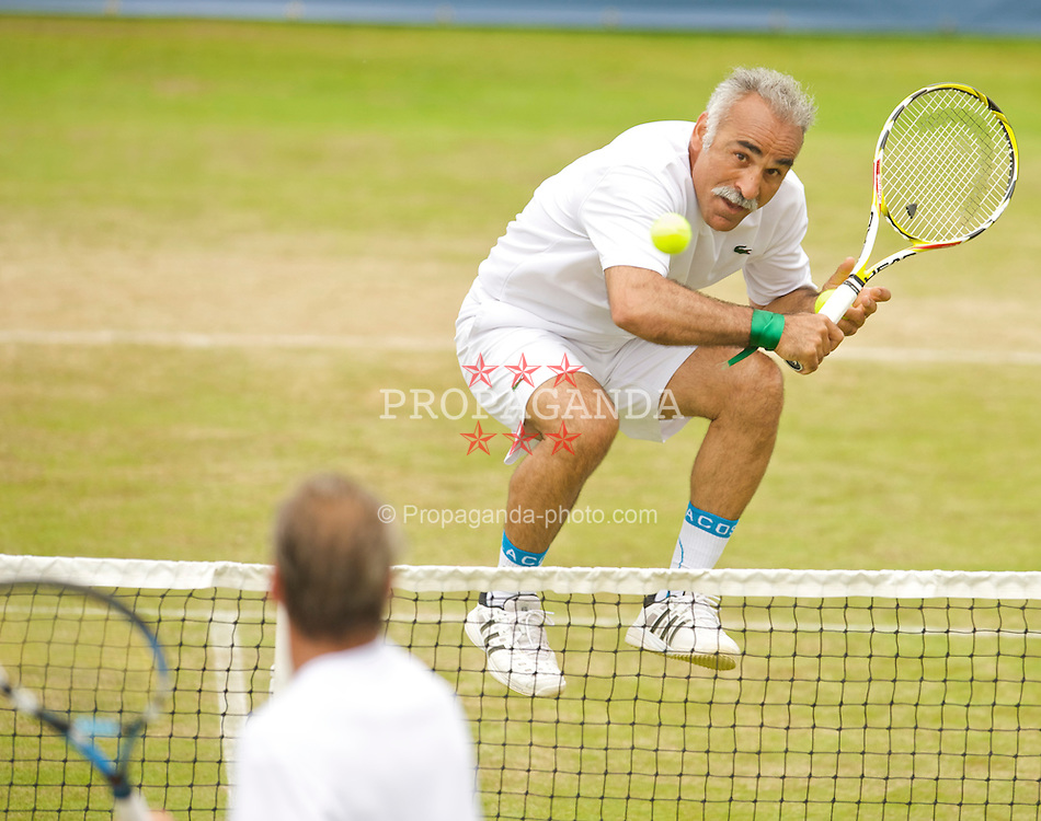 LIVERPOOL, ENGLAND - Sunday, June 21, 2009: Mansour Bahrami (IRN), wearing green ribbons on his right wrist in support of the protesters in Iran, during Day Five of the Tradition ICAP Liverpool International Tennis Tournament 2009 at Calderstones Park. (Pic by David Rawcliffe/Propaganda)