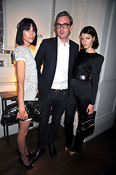 Left to right, LIBERTY ROSS, PAURIC SWEENEY and BEN GRIMES at a dinner hosted by designer Pauric Sweeney held in The Postilion Roon, The Langham, ondon on 23rd June 2009.