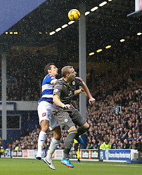 Leicester City's Ritchie De Laet and Queen Park Rangers' Gary O'Neil battle for the ball in the rain - Photo mandatory by-line: Robin White/JMP - Tel: Mobile: 07966 386802 21/12/2013 - SPORT - FOOTBALL - Loftus Road - London - Queens Park Rangers v Leicester City - Sky Bet Championship