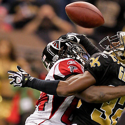 2009 November 02:  Atlanta Falcons wide receiver Roddy White (84) hits New Orleans Saints cornerback Jabari Greer (32) to prevent an interception during the second half at the Louisiana Superdome in New Orleans, Louisiana.