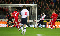 BOLTON, ENGLAND - Saturday, January 21, 2011: Bolton Wanderers' Mark Davies scores the first goal against Liverpool during the Premiership match at the Reebok Stadium. (Pic by David Rawcliffe/Propaganda)