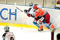 Veideman Adrian of EHC Linz during ice-hockey match between HK Acroni Jesenice and EHC Liwest Black Wings Linz in 43rd Round of EBEL league, on Januar 17, 2012 at Dvorana Podmezaklja, Jesenice, Slovenia. (Photo By Urban Urbanc / Sportida)