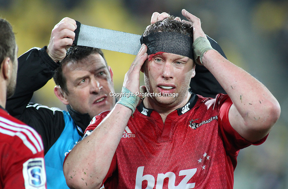 Crusaders' Wyatt Crockett has some head tape applied during the Round 17 Super Rugby match, between the Hurricanes & Crusaders. Westpac Stadium, Wellington. 28 June 2014. Photo.: Grant Down / www.photosport.co.nz
