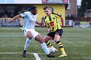 Harrogate Town midfielder Joe Leesley (11) takes on Braintree Town defender Jonathan Muleba (2) during the Vanarama National League match between FC Halifax Town and Dover Athletic at the Shay, Halifax, United Kingdom on 17 November 2018.