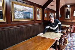 © Licensed to London News Pictures. 03/07/2020. London, UK. A staff member cleans a table in The Toll Gate, a Wetherspoon pub in north London as the pub prepares to reopen on 4 July, the 'Super Saturday'. Pubs across the UK closed on 23 March following the coronavirus lockdown. As COVID-19 lockdown restrictions are eased, pubs will reopen on Saturday 4 July. Some pubs are planning to reopen from 6am. Photo credit: Dinendra Haria/LNP