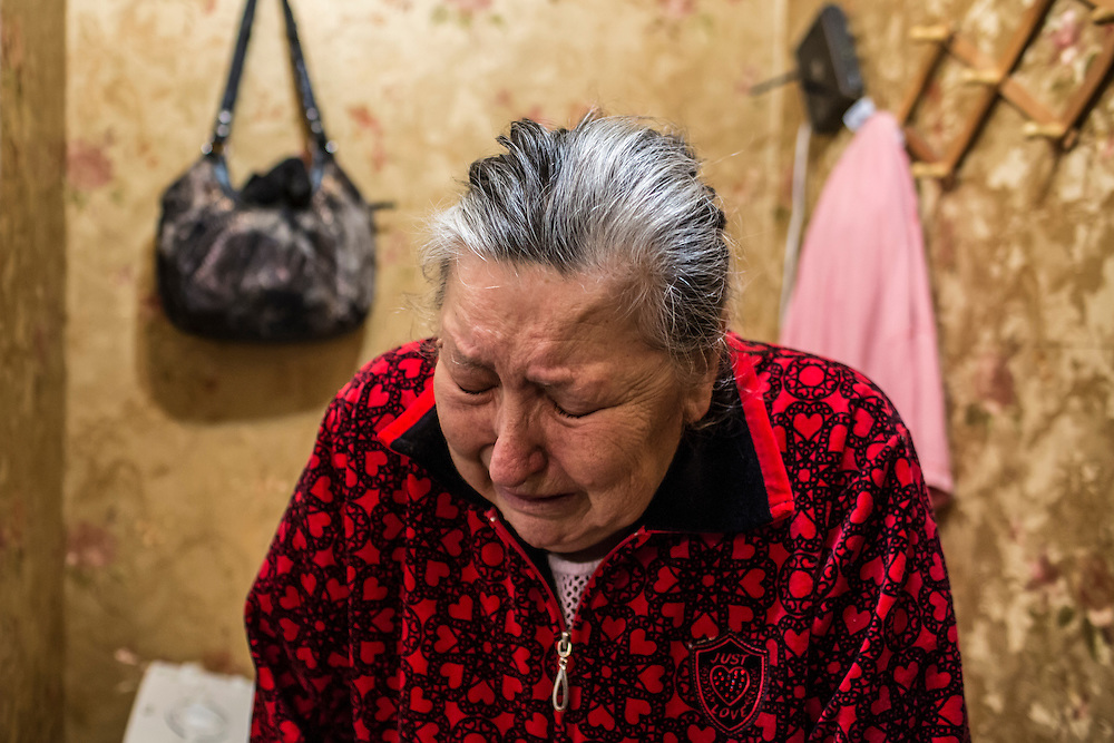 DONETSK, UKRAINE - FEBRUARY 2, 2015: Yekaterina Malkova, 71, whose apartment was damaged when a shell landed just ouside the building overnight in Donetsk, Ukraine. Malkova is paralyzed on the left side of her body, making it difficult to travel. Her daughter lives in the United States, and her husband passed away on January 27 of this year. Ongoing fighting has killed scores of civilians since a tenuous ceasefire collapsed in late January. CREDIT: Brendan Hoffman for The New York Times