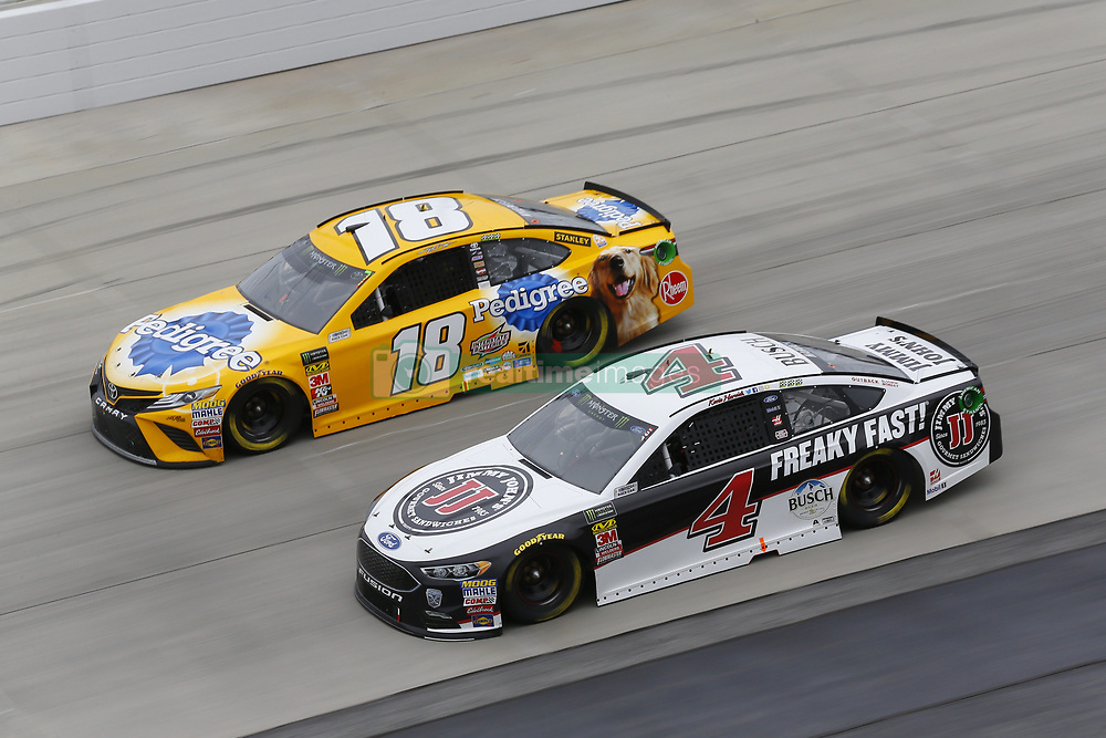 May 6, 2018 - Dover, Delaware, United States of America - Kyle Busch (18) and Kevin Harvick (4) battle for position during the AAA 400 Drive for Autism at Dover International Speedway in Dover, Delaware. (Credit Image: © Chris Owens Asp Inc/ASP via ZUMA Wire)