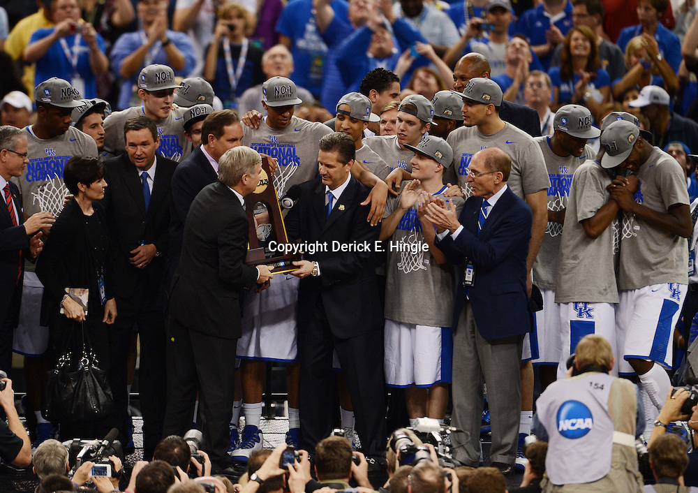 Apr 2, 2012; New Orleans, LA, USA; Kentucky Wildcats head coach John Calipari holds the NCAA National Championship trophy after defeating the Kansas Jayhawks 67-59 during the second half in the finals of the 2012 NCAA men's basketball Final Four at the Mercedes-Benz Superdome. Mandatory Credit: Derick E. Hingle-US PRESSWIRE