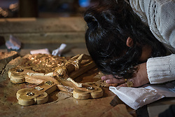 19 April 2019, Jerusalem: A woman  marks Good Friday (Western tradition), praying by the Stone of Anointing, where Jesus is said to have been prepared for burial after his crucifixion.