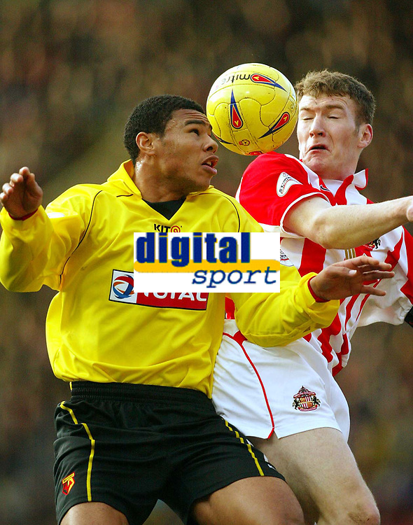 Photo: Scott Heavey.<br />Watford v Sunderland. Nationwide Division One. 07/02/2004.<br />Jerel Ifil (L) and Kevin Kyle battle in the air