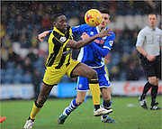 Lucas Akins, Matt Lund during the Sky Bet League 1 match between Rochdale and Burton Albion at Spotland, Rochdale, England on 30 January 2016. Photo by Daniel Youngs.