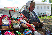"""A vendor sells handmade dolls for children on a walkway near the Volga River in Uglich, Russia. As one of Russia's """"Golden Ring"""" cities, Uglich is designated a town of significant cultural importance."""
