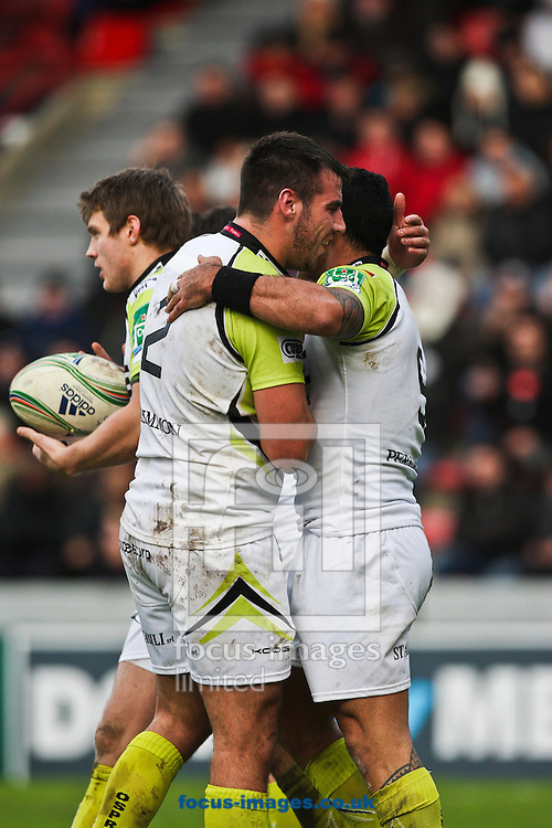 Picture by Trevor Wright/Focus Images Ltd +33 6841 92222.08/12/2012.Scott baldwin and Kahn FotualI'I of Ospreys celebrate the try during the Heineken Cup match at Stade des Sept Deniers, Toulouse.