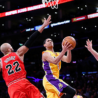 29 January 2015: Los Angeles Lakers guard Jordan Clarkson (6) goes for the layup past Chicago Bulls forward Taj Gibson (22) and Chicago Bulls forward Pau Gasol (16) during the Los Angeles Lakers 123-118 2OT victory over the Chicago Bulls, at the Staples Center, Los Angeles, California, USA.