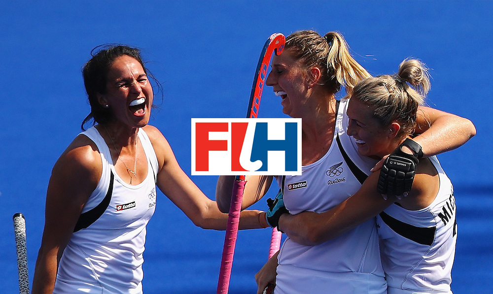 RIO DE JANEIRO, BRAZIL - AUGUST 19:  Olivia Merry #4 (C) celebrates with Kayla Whitelock #1 and Stacey Michelsen #31 of New Zealand after scoring a goal during the Women's Bronze Medal Match against Germany on Day 14 of the Rio 2016 Olympic Games at the Olympic Hockey Centre on August 19, 2016 in Rio de Janeiro, Brazil.  (Photo by Tom Pennington/Getty Images)