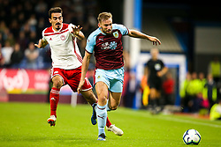 Charlie Taylor of Burnley goes past Lazaros Christodoulopoulos of Olympiakos - Mandatory by-line: Robbie Stephenson/JMP - 30/08/2018 - FOOTBALL - Turf Moor - Burnley, England - Burnley v Olympiakos - UEFA Europa League Play-offs second leg